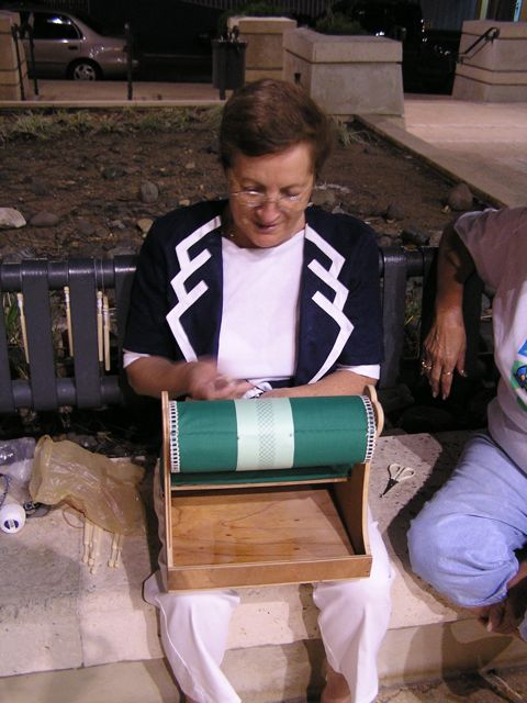 Ada brought her mundillo to make lace at the Plaza during the evening